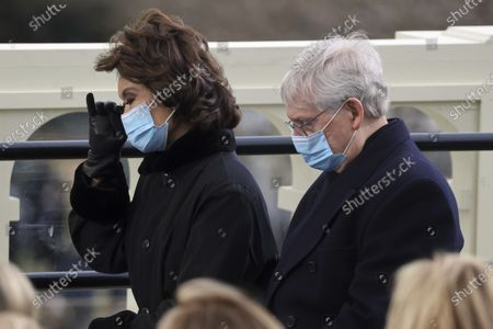 Senator Mitch McConnell, R-Ky., and his wife Elaine Chao attend President-elect Joe Biden's inauguration ceremony, in Washington