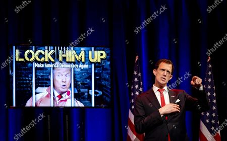 Stock Image of US stand-up comedian Greg Shapiro watches the inauguration of US President Joe Biden and Vice President Kamala Harris in comedy club Boom Chicago in Amsterdam, Netherlands, 20 January 2021. With the departure of Donald J. Trump, comedians Shapiro and Pep Rosenfeld wrap up their show 'Lock Him Up' which was about the presidential election.