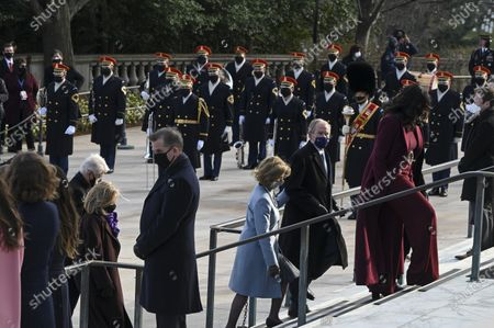 Former President George W. Bush (C-R) and former First Lady Laura Bush (C-L) participate in a wreath-laying ceremony at the Tomb of the Unknown Soldier at the Arlington National Cemetery, in Arlington, Virginia, USA, 20 January 2021. Joe Biden was sworn in earlier on the same day and became the 46th President of the United States.
