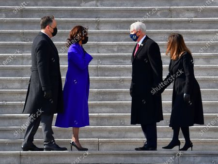 Vice President Kamala Harris and husband Douglas Emhoff exchange words with former Vice President Mike Pence and wife Karen Pence on the east side steps of the U.S. Capitol after the 59th Presidential Inauguration in Washington on