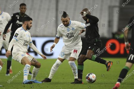 Lens' Gael Kakuta, right, tries to keep the ball as Marseille's Morgan Sanson, left, and Marseille's Dimitri Payet, center, defend during the French League One soccer match between Marseille and Lens at the Veledrome stadium in Marseille, France