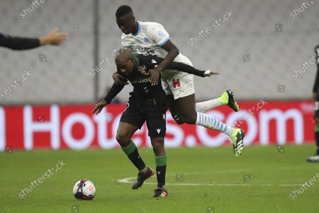 Marseille's Pape Gueye, top, stops Lens' Gael Kakuta during the French League One soccer match between Marseille and Lens at the Veledrome stadium in Marseille, France