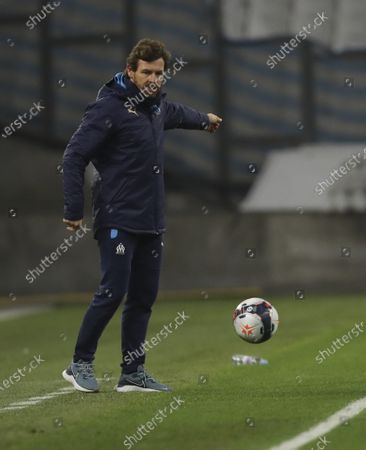 Stock Picture of Marseille's head coach Andre Villas-Boas kicks the ball during the French League One soccer match between Marseille and Lens at the Veledrome stadium in Marseille, France
