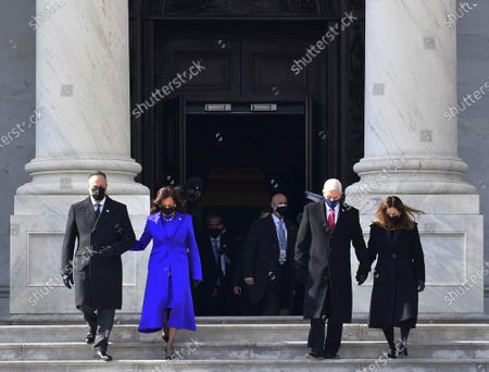 Vice President Kamala Harris, husband Douglas Emhoff, former Vice President Mike Pence and Wife Karen Pence walk down the east side steps of the U.S. Capitol after the Presidential Inauguration in Washington on