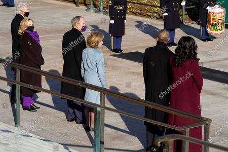 Former President Bill Clinton and former Secretary of State Hillary Clinton, former President George W. Bush and former first lady Laura Bush, and former President Barack Obama and former first lady Michelle Obama, wait President Joe Biden and Vice President Kamala Harris to lay a wreath at the Tomb of the Unknown Soldier at the Arlington National Cemetery, in Arlington, Va., . Joshua Roberts/Pool photo via AP