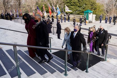 Former President Bill Clinton and former Secretary of State Hillary Clinton, right, former President George W. Bush and former first lady Laura Bush, center and former President Barack Obama and former first lady Michelle Obama, walk after President Joe Biden and Vice President Kamala Harris placed a wreath at the Tomb of the Unknown Soldier at the Arlington National Cemetery, in Arlington, Va