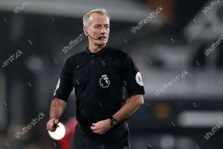 Main referee Martin Atkinson in action during the English Premier League soccer match between Fulham FC and Manchester United in London, Britain, 20 January 2021.