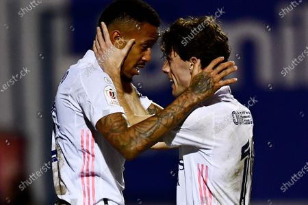 Real Madrid's Eder Militao, left, celebrates with Alvaro Odriozola after scoring his side's opening goal during a Spanish Copa del Rey round of 32 soccer match between Alcoyano and Real Madrid at the El Collao stadium in Alcoy, Spain