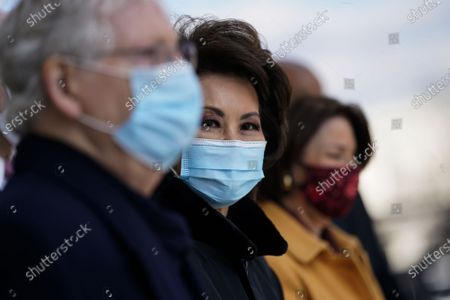 Stock Image of Sen. Mitch McConnell (R-Ky.) and former Secretary of Transportation Elaine Chao (C) depart after the inauguration of President Joe Biden in Washington, DC, USA, 20 January 2021. Biden won the 03 November 2020 election to become the 46th President of the United States of America.