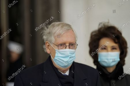 Sen. Mitch McConnell (R-Ky.) and former Secretary of Transportation Elaine Chao (R) depart after the inauguration of President Joe Biden in Washington, DC, USA, 20 January 2021. Biden won the 03 November 2020 election to become the 46th President of the United States of America.