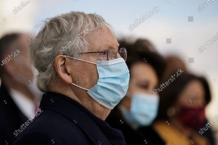 Stock Picture of Sen. Mitch McConnell (R-Ky.) and former Secretary of Transportation Elaine Chao depart after the inauguration of President Joe Biden in Washington, DC, USA, 20 January 2021. Biden won the 03 November 2020 election to become the 46th President of the United States of America.