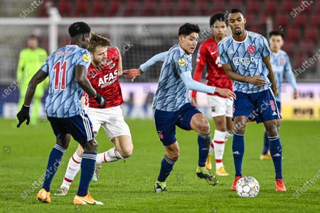 Stock Image of (lr) Quincy Promes of Ajax, Fredrik Midtsjo of AZ, Edson Alvarez of Ajax, Ryan Gravenberch of Ajax during the Dutch Toto KNVB cup match between AZ Alkmaar and Ajax at the AFAS stadium in Alkmaar, The Netherlands, 20 January 2021.