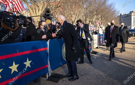 Stock Image of US President Joe Biden talks with NBC Reporter Mike Memoli as he and and First Lady Dr. Jill Biden walk along Pennsylvania Avenue in front of the White House, in Washington, DC, USA, 20 January 2021. Joe Biden was sworn in earlier on the same day and became the 46th President of the United States.