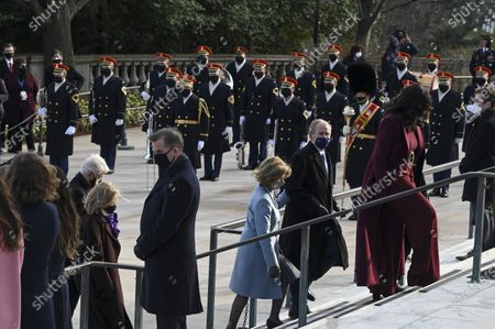 Former President George W. Bush and former First Lady Laura Bush pass an Honor Guard participating in a wreath-laying ceremony at the Tomb of the Unknown Soldier in Arlington National Cemetery in Arlington, Virginia