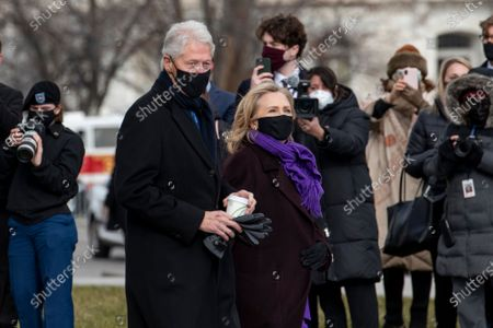Former President Bill Clinton and former First Lady Hilary Rodham Clinton depart the US Capitol following the inauguration of United States President Joe Biden and Vice President Kamala Harris in Washington, DC.