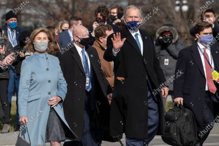 Stock Image of Former President George W. Bush and former First Lady Laura Bush depart the US Capitol following the inauguration of United States President Joe Biden and Vice President Kamala Harris in Washington, DC.