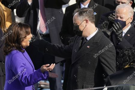 Vice President Kamala Harris hugs her husband Doug Emhoff after being sworn in as vice president by Supreme Court Justice Judge Sonia Sotomayor during the 59th Presidential Inauguration at the U.S. Capitol