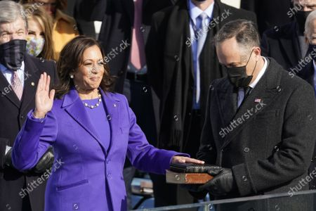 Kamala Harris is sworn in as vice president by Supreme Court Justice Judge Sonia Sotomayor as her husband Doug Emhoff holds the Bible during the 59th Presidential Inauguration at the U.S. Capitol