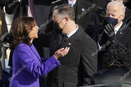 Stock Picture of Vice President Kamala Harris hugs her husband Doug Emhoff after being sworn in as vice president by Supreme Court Justice Judge Sonia Sotomayor during the 59th Presidential Inauguration at the U.S. Capitol