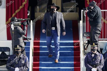 Garth Brooks arrives to sing Amazing Grace during the 59th Presidential Inauguration at the U.S. Capitol in Washington, DC on Wednesday, January 20, 2021.
