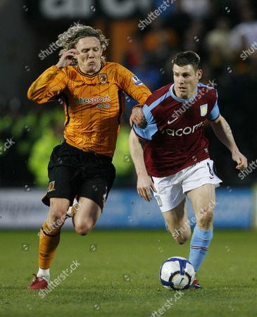 Jimmy Bullard of Hull City and James Milner of Aston Villa