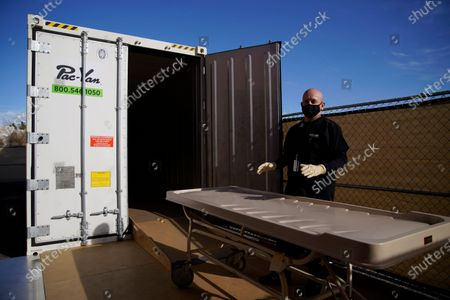 Michael Murphy, a consultant serving as interim Clark County coroner, gives a tour of a refrigerated trailer at the coroner's office in Las Vegas. Nevada reported 71 new deaths from the coronavirus on Wednesday, Jan. 20, surpassing the highest single-day death toll, the 63 reported just last Saturday
