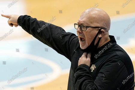 Wake Forest head coach Steve Forbes directs his team during the second half of an NCAA college basketball game against North Carolina in Chapel Hill, N.C