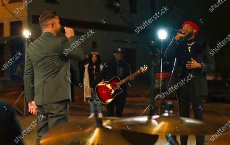 In this image from video, Justin Timberlake, left, and Ant Clemons perform during the Celebrating America event, following the inauguration of Joe Biden as the 46th president of the United States