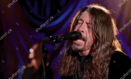 Stock Image of In this image from video, Dave Grohl, of Foo Fighters, performs during the Celebrating America event, following the inauguration of Joe Biden as the 46th president of the United States