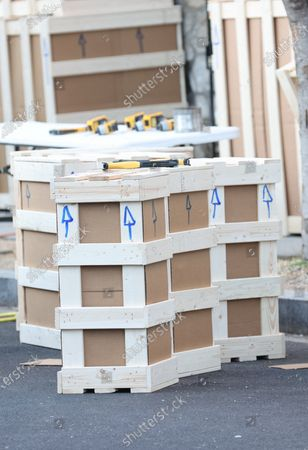 Stock Image of Jared Kushner and Ivanka Trump's hired moving company, prep custom-built moving boxes for delivery to Miami