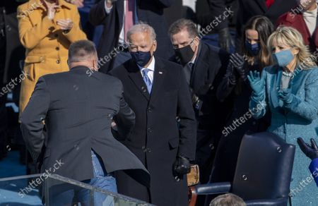 """Garth Brooks greets President Joe Biden after he sang """"Amazing Grace"""" during the Inauguration of Biden as the 46th President of the United States at the U.S. Capitol in Washington, DC on Wednesday, January 20, 2021."""