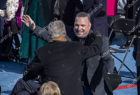 """Garth Brooks hugs former President George W. Bush after Brooks sang """"Amazing Grace"""" during the Inauguration of President Biden as the 46th President of the United States at the U.S. Capitol in Washington, DC on Wednesday, January 20, 2021."""