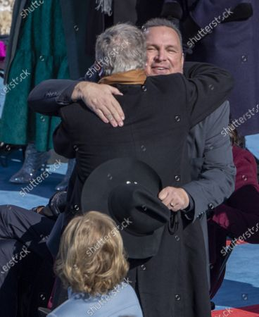 "Garth Brooks hugs former President George W. Bush after Brooks sang ""Amazing Grace"" during the Inauguration of President Biden as the 46th President of the United States at the U.S. Capitol in Washington, DC on Wednesday, January 20, 2021."