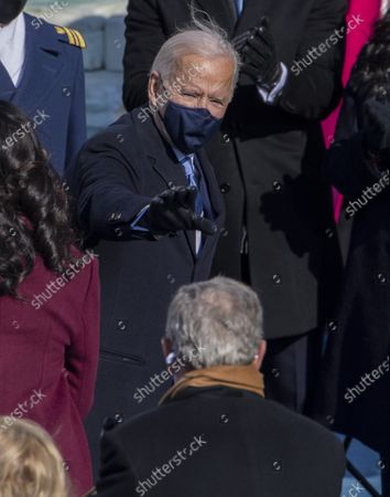 President Joe Biden greets former President George W. Bush as he departs after the Inauguration Ceremony at the U.S. Capitol in Washington, DC on Wednesday, January 20, 2021.