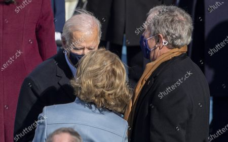 President Joe Biden greets former President George W. Bush and wife Laura Bush as he departs after the Inauguration Ceremony at the U.S. Capitol in Washington, DC on Wednesday, January 20, 2021