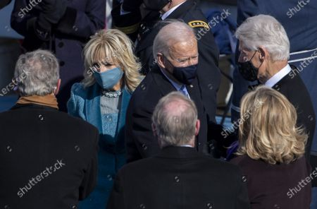President Joe Biden greets former President Bill Clinton as first lady Dr. Jill Biden greets former President George W. Bush as they depart after the Inauguration Ceremony at the U.S. Capitol in Washington, DC on Wednesday, January 20, 2021