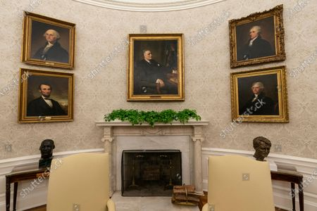 The Oval Office of the White House is newly redecorated for the first day of President Joe Biden's administration, in Washington, including a pairing of former President Franklin D. Roosevelt over the mantle of the fireplace