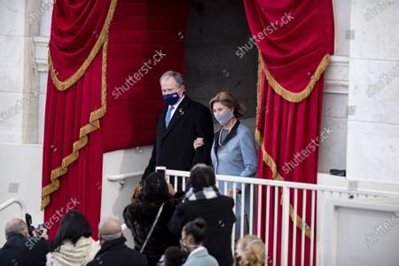 Former U.S. President George W. Bush (L, Rear) and his wife Laura Bush arrive to attend the inauguration ceremony of the 46th President of the United States in Washington, D.C., the United States, on Jan. 20, 2021. At an unusual inauguration closed to public due to the still raging coronavirus pandemic, U.S. President-elect Joe Biden was sworn in as the 46th President of the United States on Wednesday at the West Front of the Capitol, which was breached two weeks ago by violent protesters trying to overturn his election victory.