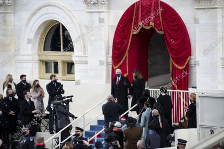 U.S. Vice President Mike Pence (C-L) and his wife Karen Pence arrive to attend the inauguration ceremony of the 46th President of the United States in Washington, D.C., the United States, on Jan. 20, 2021. At an unusual inauguration closed to public due to the still raging coronavirus pandemic, U.S. President-elect Joe Biden was sworn in as the 46th President of the United States on Wednesday at the West Front of the Capitol, which was breached two weeks ago by violent protesters trying to overturn his election victory.