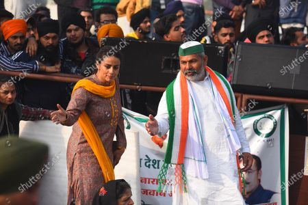 Activst and actor Gul Panag along with Bharatiya Kisan Union (BKU) leader Rakesh Tikait at  Ghazipur border where farmers are camped in protest against the new farm laws, on January 19, 2021 in New Delhi, India.