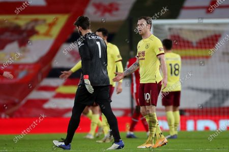 Ashley Barnes of Burnley reacts to Liverpool goalkeeper Alisson Becker at the end of the match as the goalkeeper refuses to acknowledge him