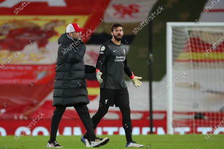 Liverpool goalkeeper Alisson Becker speaks with Jurgen Klopp at the end of the game