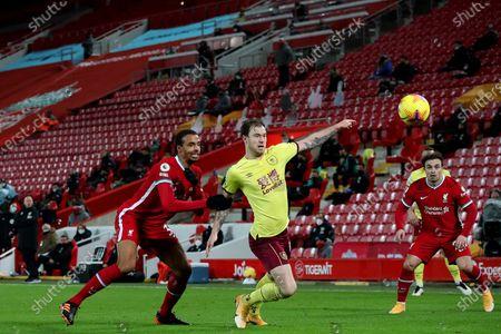 Joel Matip of Liverpool and Ashley Barnes of Burnley