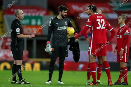Joel Matip of Liverpool speaks with referee Mike Dean