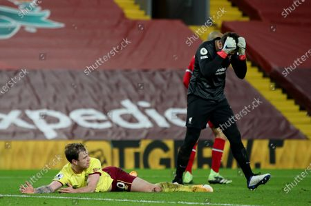 Reaction from Liverpool goalkeeper Alisson Becker after Burnley are awarded a penalty