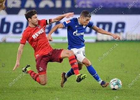 Stock Picture of Amine Harit (Schalke 04), re., gegen Jonas Hector (1.FC Koeln)
