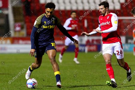 Dan Barlaser of Rotherham United closes in on Jacob Brown of Stoke City