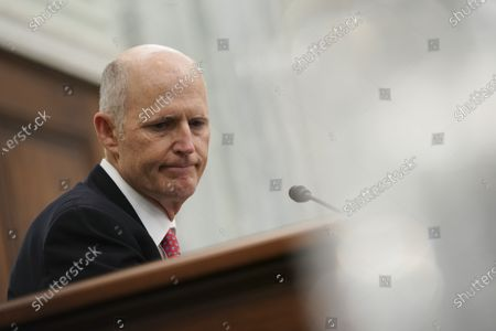 """Stock Picture of United States Senator Rick Scott (Republican of Florida), pauses during a Senate Commerce, Science and Transportation Committee confirmation hearing for U.S. Secretary of Transportation nominee Pete Buttigieg in Washington, D.C., U.S.,. Buttigieg, is pledging to carry out the administration's ambitious agenda to rebuild the nation's infrastructure, calling it a """"generational opportunity"""" to create new jobs, fight economic inequality and stem climate change."""