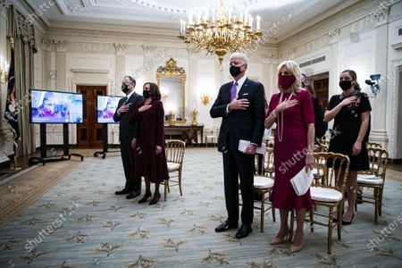 U.S. President Joe Biden, U.S. First Lady Dr. Jill Biden, U.S. Vice President Kamala Harris, and her husband Doug Emhoff, place their hands over their hearts as Patti LaBelle sings the National Anthem, during a virtual presidential inaugural prayer service in the State Dining Room of the White House in Washington, DC on Thursday, January 21, 2021.