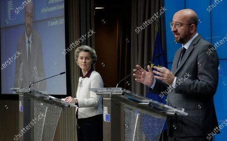 European Commission President Ursula von der Leyen, left, listens to European Council President Charles Michel during a joint news conference at the end of a EU summit video conference at the European Council headquarters in Brussels, . European Union leaders assessed more measures to counter the spread of coronavirus variants during a video summit Thursday as the bloc's top disease control official said urgent action was needed to stave off a new wave of hospitalizations and deaths